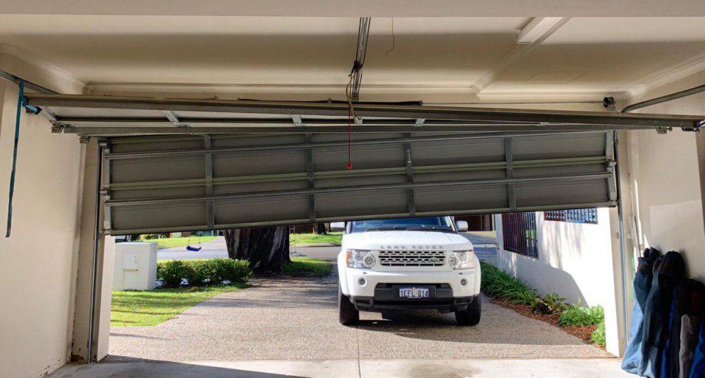 Car Damages Garage Door